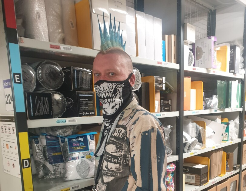 Martyn Janes wearing a facemask and standing in the fulfilment centre.