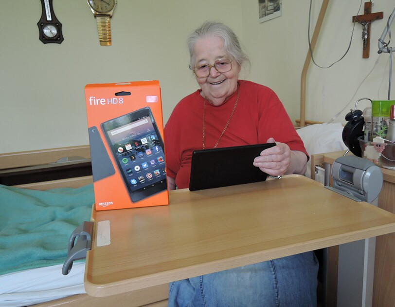 A person received a Kindle device from Amazon.