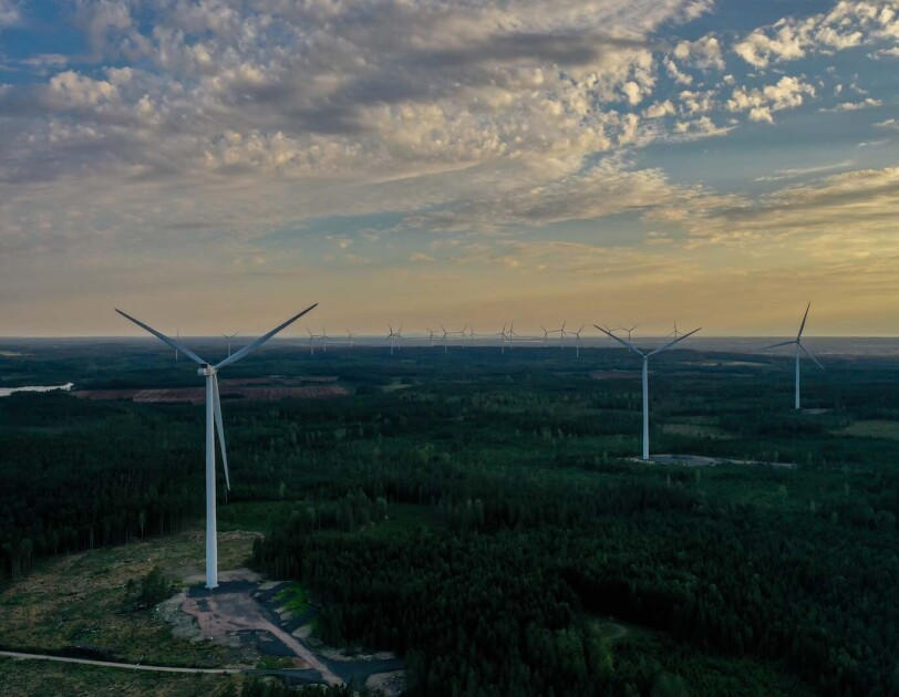 Photo of wind turbines in spread across the horizon in Bäckhammar, Sweden